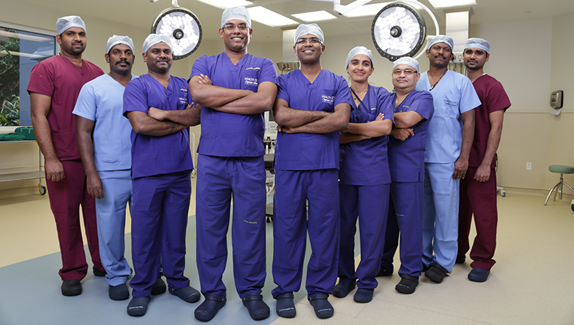 Dr Alwin and Dr Niranjan with OR team
