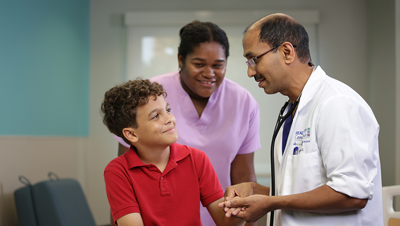 Dr Binoy with boy and nurse