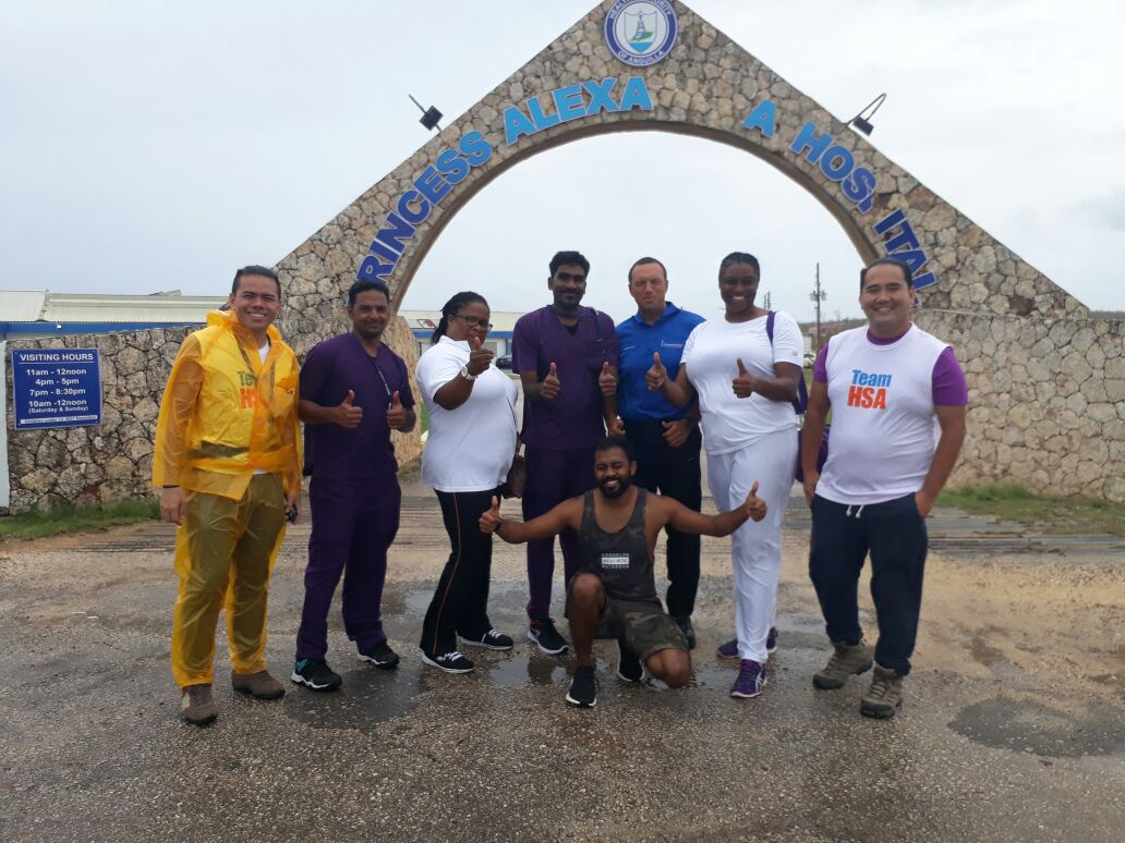 Health City Cayman Islands nurses Mahesh Kumara (2nd from right) and Bijin Mohan (center) with some of the CI Health Services Authority team members at Princess Alexandra Hospital in Stoney Ground, Anguilla