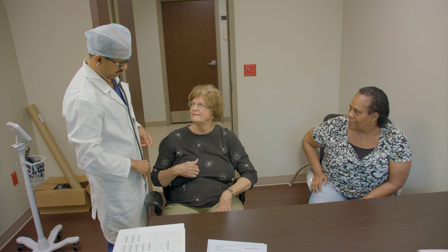 Dr. BInoy with patient Zoe Bodden
