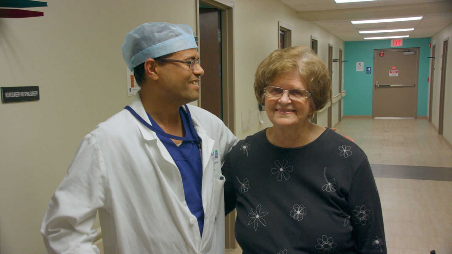Dr. Dhruva with patient Zoe Bodden