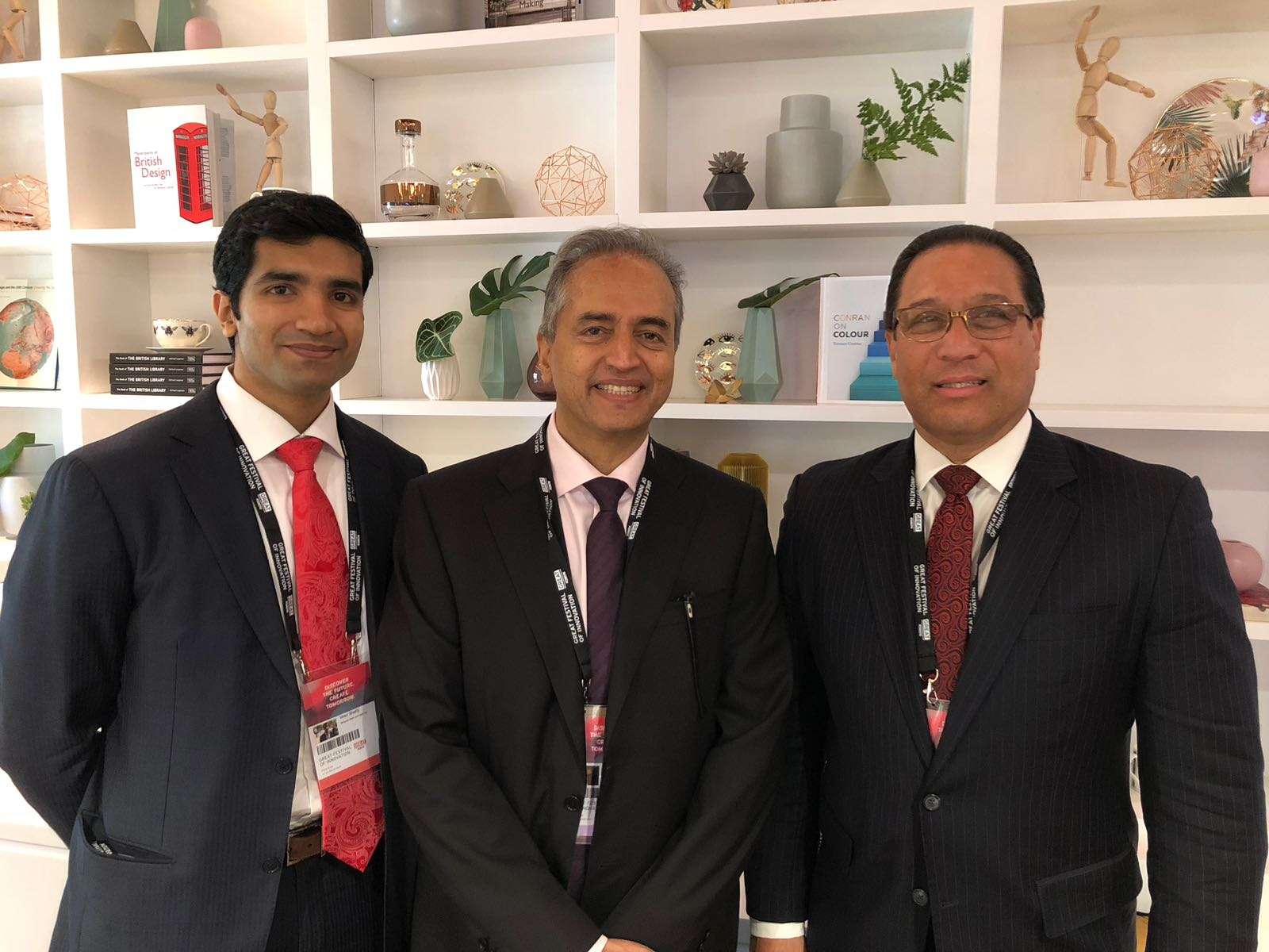 Dr. Devi Shetty is flanked by his son Viren Shetty and Cayman Islands Premier Hon. Alden McLaughlin
